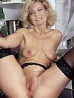 Horny granny stuffs pussy with huge dildoe