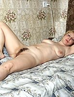 Blonde mature shows her chubby hairy pussy